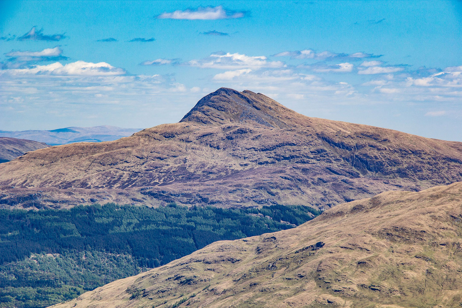 Ben Lomond is a munro with stunning surroundings that can be visited on a private tour of Scotland