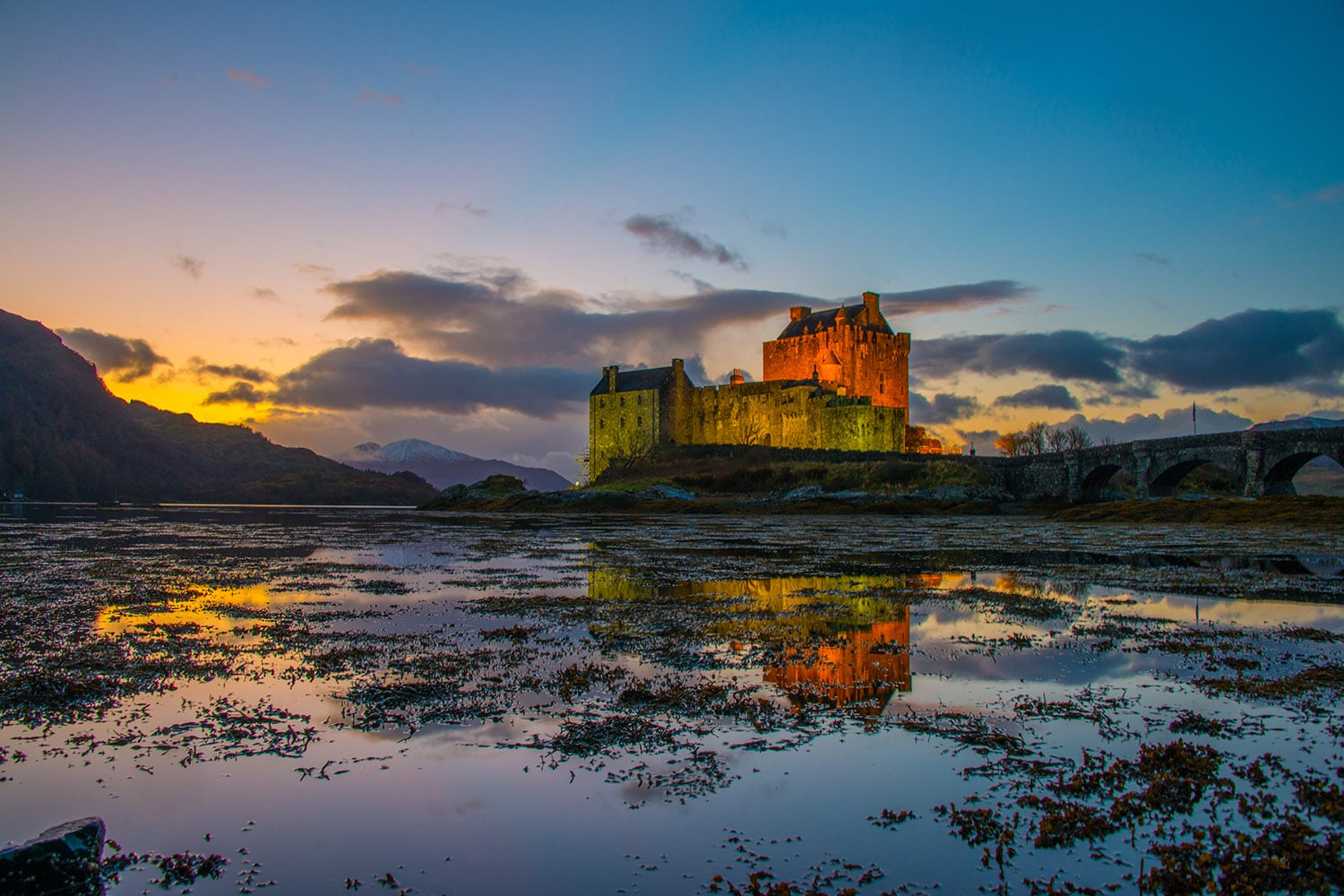 A lovely view of Eilean Donan Castle at sunset, featured in our private tours of Scotland