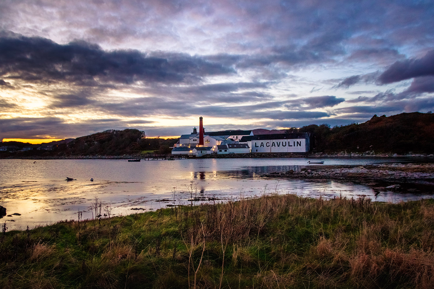Lagavulin Distillery in Islay, a distillery that can be visited on our Scottish whisky tour - Scottish Spirit