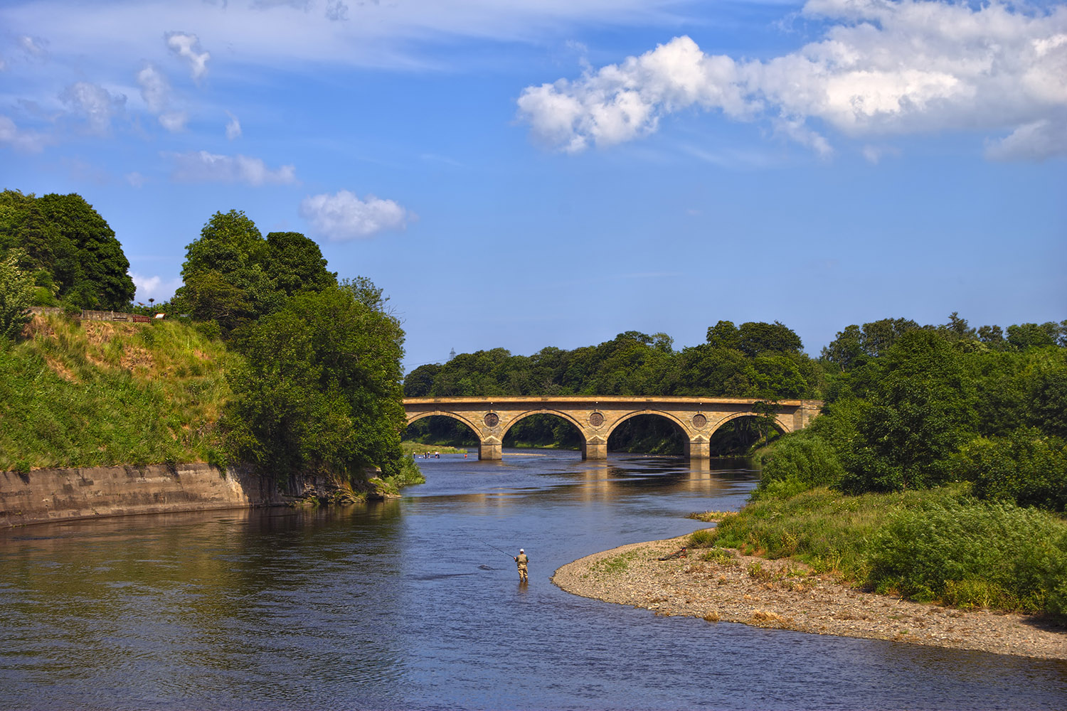 The River Tweed flows across the border region of Scotland and England, a stop on our border raiders tour of Scotland