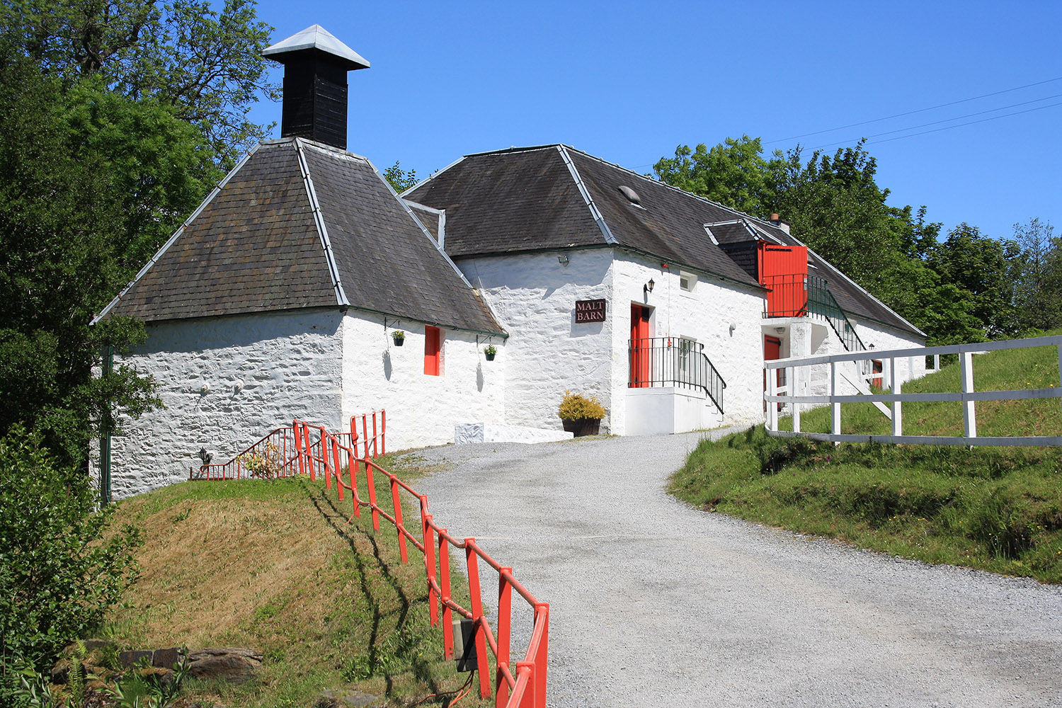 A whisky distillery in the highlands, available to visit on a private tour of Scotland